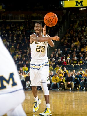 Michigan guard Caris LeVert passes against Youngstown State at the Crisler Center in Ann Arbor on Dec. 19, 2015.