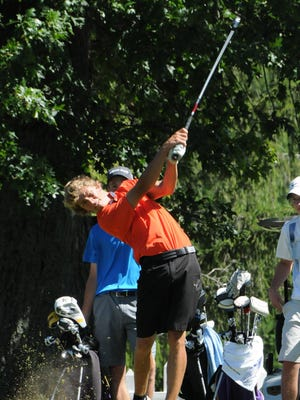 Kaleb Smith drives the ball at Twin Lakes en route to winning the boys 17-18 division and posting the best overall two-day total in the Richland County Juniors Tournament.