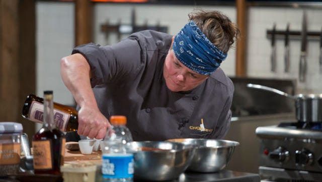 Chef Carrie Eagle cooks Husk cherry and blueberry cobbler with mascarpone buttermilk whip, candied pig skin dust and an orange cognac shot during the dessert round, as seen on Food Network's Chopped, Season 32.