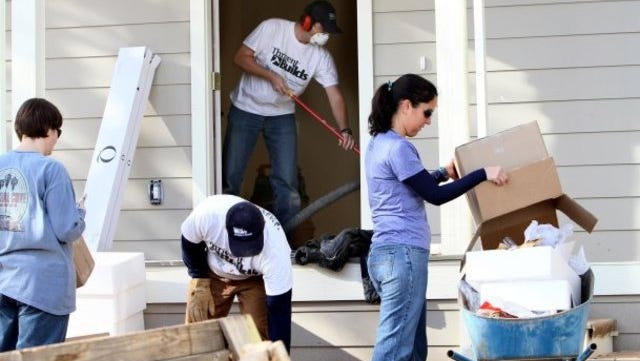 Volunteers from Thrivent Financial for Lutherans work on building a Habitat for Humanity house in late 2011 for Candice Lane and her three children in Shasta Lake.