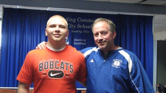 Reading senior Michael McKinney (left) signed to play football at West Virginia Wesleyan today.