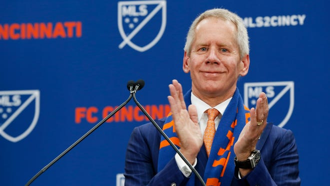 FC Cincinnati team owner Cara Lindner III applauds the supporters at Rhinegeist Brewery in the Over-the-Rhine neighborhood of Cincinnati on Tuesday, May 29, 2018. FC Cincinnati was announced as the newest expansion team to join Major League Soccer.
