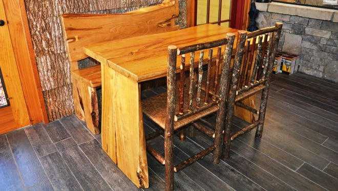 A bookmatched locust table with matching bench and bark on hickory side chairs made by Appalachian Designs.
