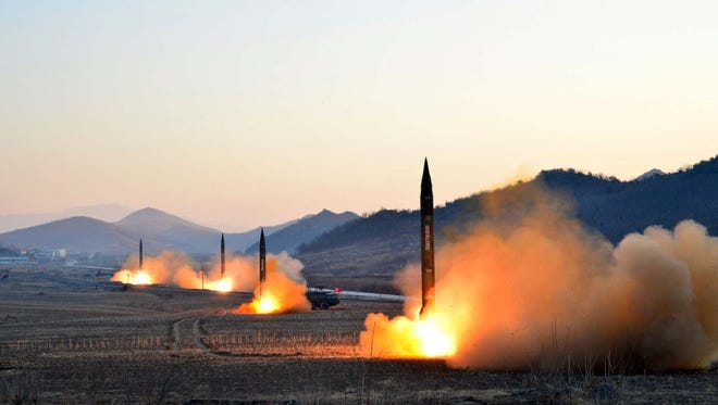 This undated picture released by North Korea's Korean Central News Agency (KCNA) on March 7 shows the launch of four ballistic missiles by North Korea during a drill.