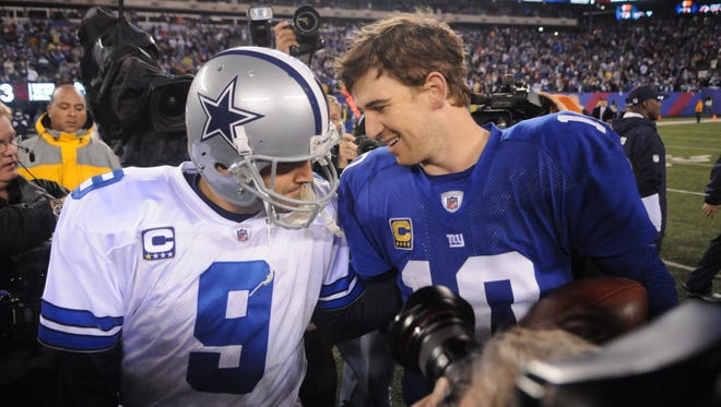 Tony Romo and Eli Manning share a moment following the latter's victory on Jan. 1, 2012 in East Rutherford.
