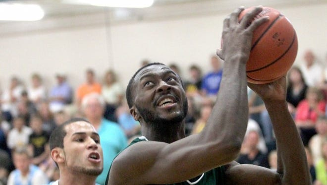 Gabe Olaseni takes it up in the paint during Prime Time League action June 23, 2013.