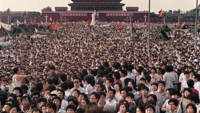 A replica of the Statue of Liberty looks over the sea of protesters in Tiananmen Square in June 1989.
