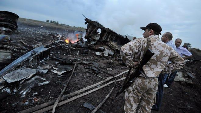 Wreckage of the Malaysian jet Thursday in rebel-held east Ukraine.