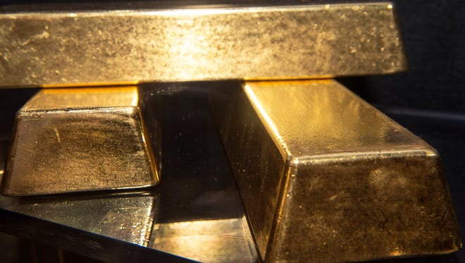 (FILES)Three .9999 fine gold bars, 400 troy ounces or 28 lbs each, with a combined value of more than  USD 2 million, are displayed at the Bureau of Engraving and Printing (BEP) in this August 27, 2012 file photo in Washington, DC. Sparked by skowing growth in China, gold plunged to its lowest level in more than two years. Gold lost about $100 an ounce to trade at just over $1,400, continuing Friday's sharp sell-off, when the precious metal slumped 5%. It is now in bear market territory, having fallen 27% from its record high in September 2011.     AFP PHOTO/Paul J. Richards/ FILESPAUL J. RICHARDS/AFP/Getty Images ORG XMIT: Gold drop ORIG FILE ID: 518928500