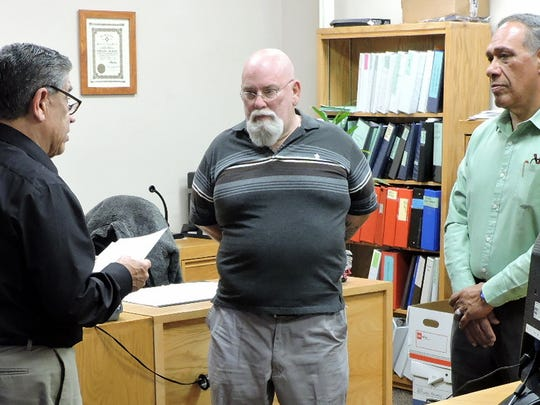 In photo at left, Esequiel Salas, on right, was sworn in as mayor of the Village of Columbus by Luna County Magistrate Court Judge, the Honorable Ray Baese. In photo at right, Village Trustees Bill Johnson, to the left of Judge Baese,and Richard Gutierrez, far right, were sworn in. The oath of office was given on Friday, March 9 at the Luna County Magistrate Courtroom.