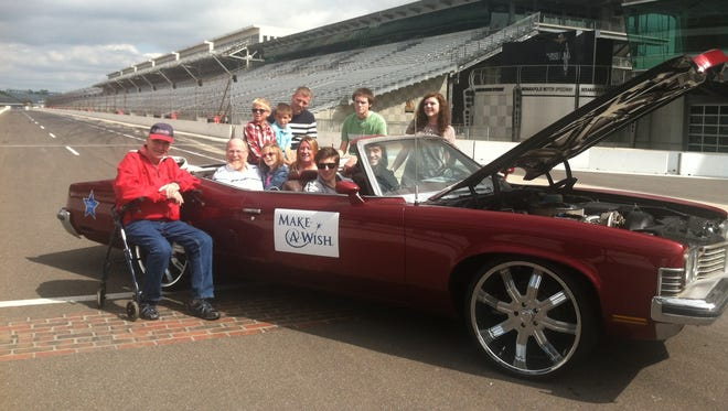 Make a Wish recipient JD Casper, 19 and his family with IndyCar driver JR Hildebrand after he receives his wish of a restored 1973 Pontiac Grand Ville two-door convertible at the Indianapolis Motor Speedway..  Casper is fighting Hodgkins lymphoma.  Sept 16, 2014