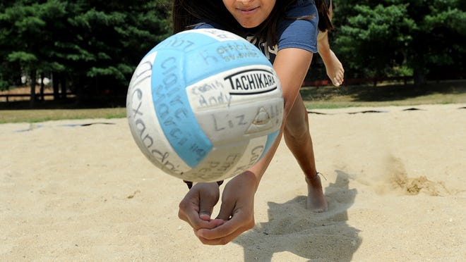 Ashland High rising junior Sneha Yadav goes after a volleyball on the sand court at the King Street Memorial Park in Franklin on Friday. Yadav has cemented herself as the Clockers' libero.
