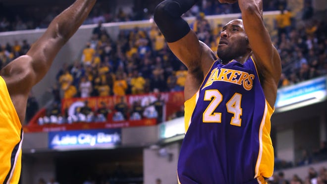 Los Angeles Lakers guard Kobe Bryant, who just surpassed Michael Jordan for third in the NBA all-time scoring leaders, shoots Monday against the Indiana Pacers at Bankers Life Fieldhouse.