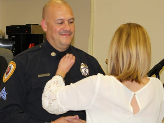 New Sergeant Shane Good receives his pin Monday night. Chambersburg Police promoted 7 officers during the ceremony.