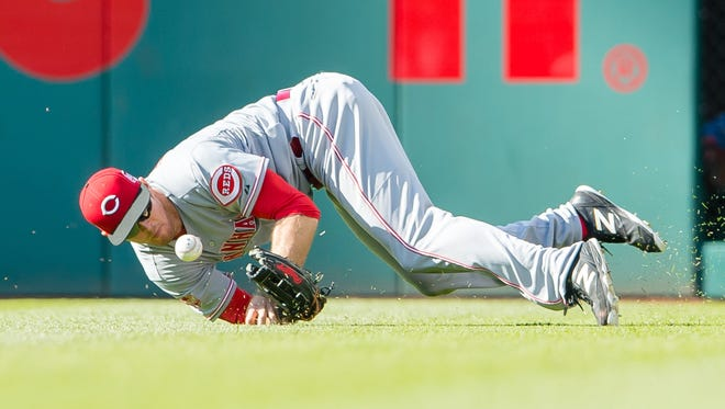 Rightfielder Brennan Boesch of the Cincinnati Reds drops a fly ball against the Cleveland Indians on May 23, 2015, in Cleveland, Ohio.
