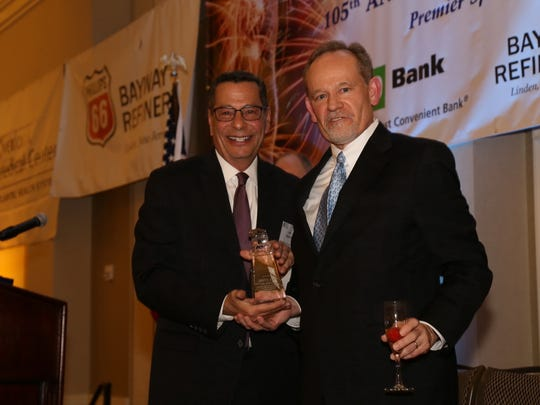 John Magnifico, left, recognizes Jim Coyle, chamber