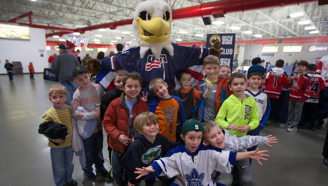 The most recent 'Rushmore' mascot has a blast with young fans at a USA Hockey NTDP game. The program is looking for somebody to fill this 'bird's' skates.