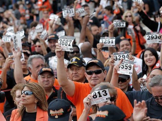 El Paso alumni show their registration for the world record attempt Saturday at El Paso High School.