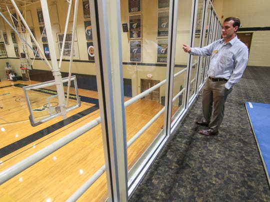 In this file photo, Anderson University associate athletic director Matthew Finley shows where new stands were set to be installed at Abney Center.
