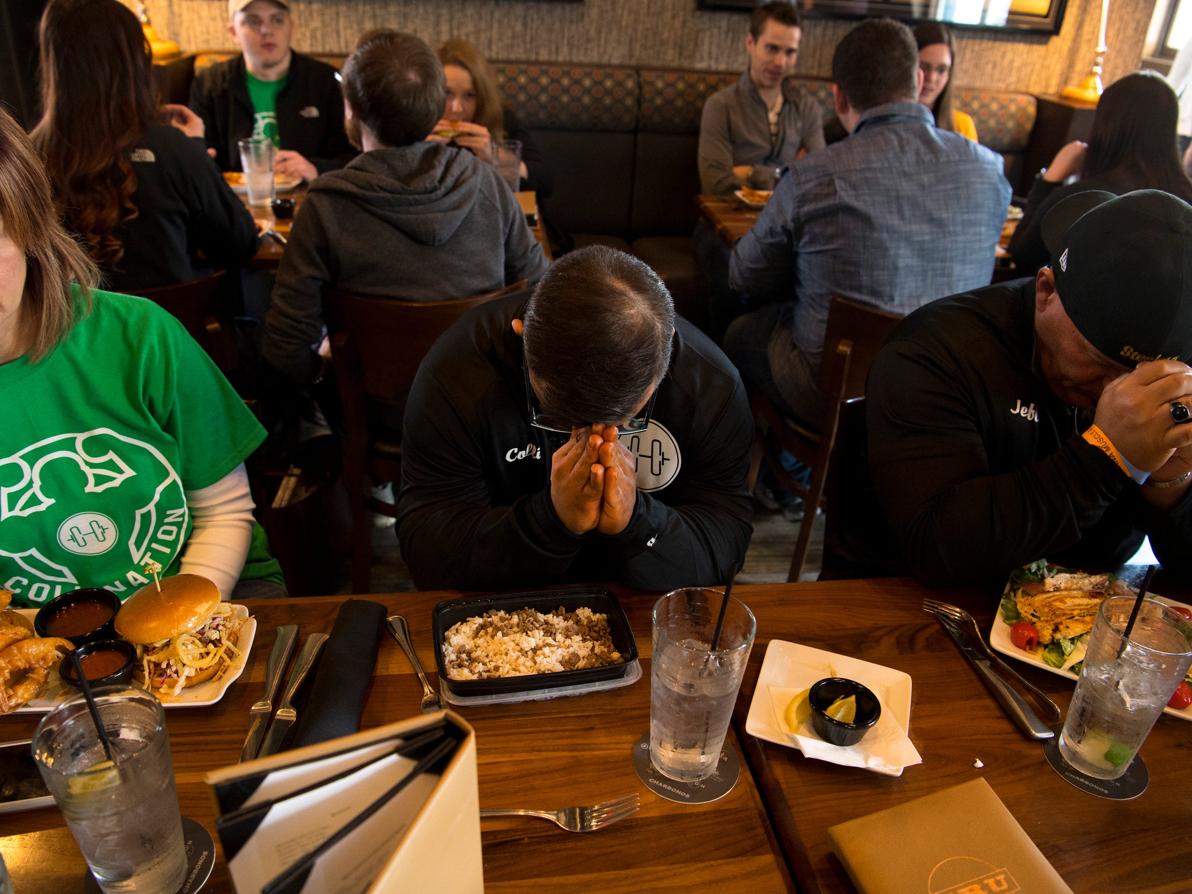A pre-meal prayer at Bru Burger in Evansville kicks