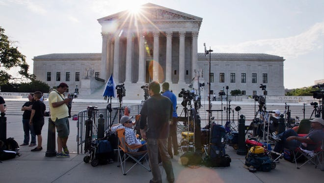 Television crews set up outside of the Supreme Court in Washington on June 25, 2015.