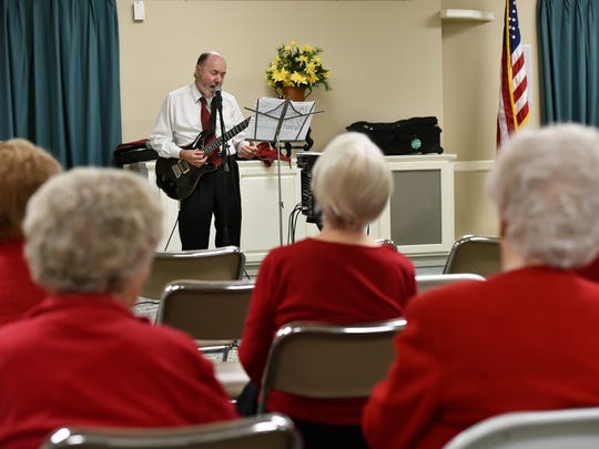 Residents of The Orchard assisted living facility in Ridgeland wear red for a Valentine's Day performance from Jerry Puckett, a Mississippi native who's worked with everyone from Paul Simon to Britney Spears.