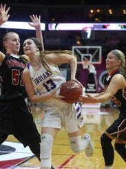 Indianola sophomore Maggie McGraw tries to drive past