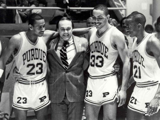 Purdue coach Gene Keady celebrates the 1988 Big Ten championship with Troy Lewis (23), Todd Mitchell (33) and Everette Stephens.