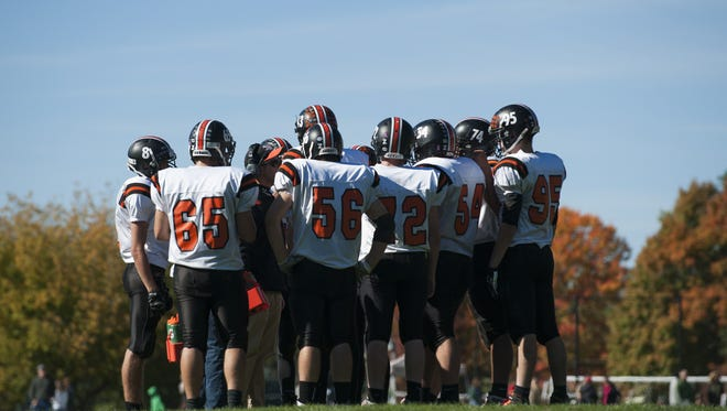 Middlebury huddles together during its high school football game at Rice on Saturday. Middlebury won 39-0.