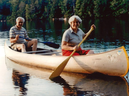 John Ayres, back left, canoes with his wife, Anne.