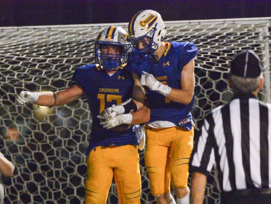 Catholic Memorial running back Tate Kopulos (left) and Luke Fox celebrate a touchdown last season. Both players will be key to the Crusaders' fortunes this year.