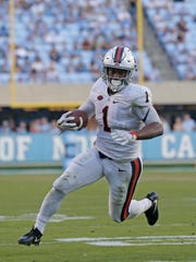 Virginia's Jordan Ellis (1) runs against North Carolina during the second half an NCAA college football game in Chapel Hill, N.C., Saturday, Oct. 14, 2017. Virginia won 20-14. (AP Photo/Gerry Broome)