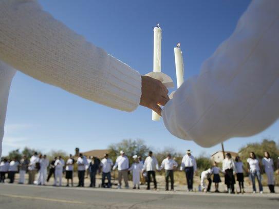 Mourners line the road to St. Elizabeth Ann Seton Parish,