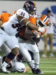 UTEP running back Joshua Fields, 20, is caught by Franklin