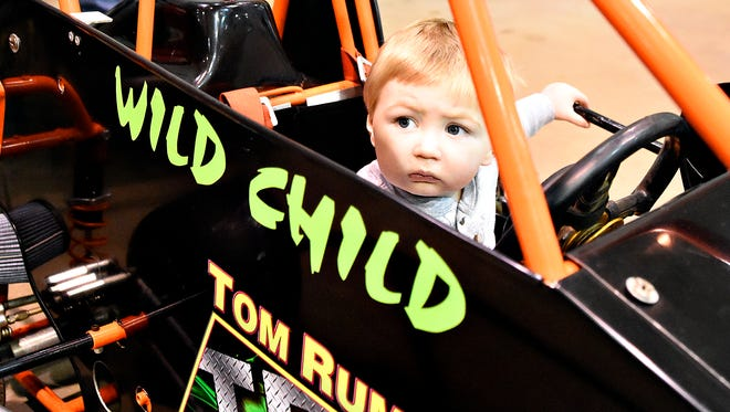 Levi Smith, 1, of New Oxford, looks out from inside a vehicle in the Kid Zone during Racing Xtravaganza at York Expo Center in York Saturday, Feb. 6, 2016. The show returns to the York Expo Center this weekend. (Dawn J. Sagert - The York Dispatch)