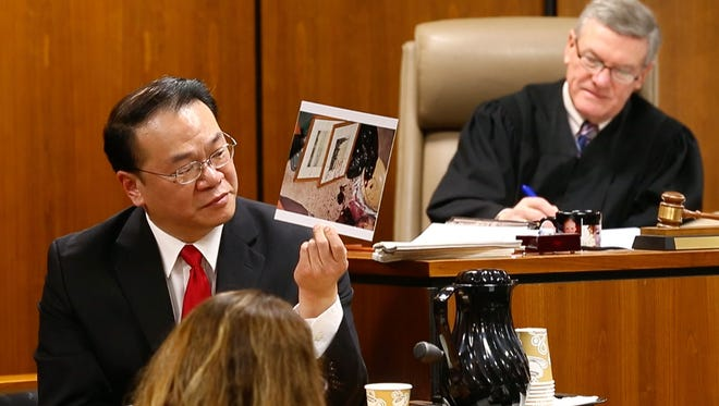 Murder trial of Alan Bienkowski, Manchester, accused of killing Anthony Verdicchio. Arthus Young, a blood spatter expert, shows the jury a crime scene photo. Judge James Blaney is on the bench—February 16, 2016 -Toms River, NJ.-Staff photographer/Bob Bielk/Asbury Park Press