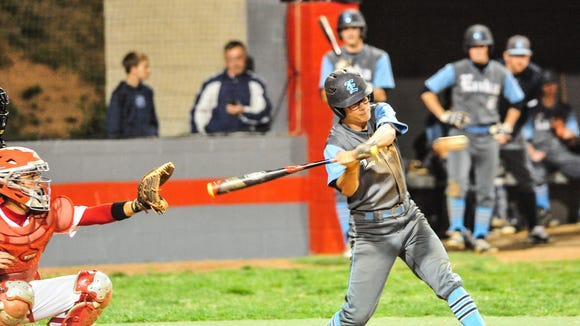 Enka's Trace Lovingood swings at a pitch Friday at Erwin.