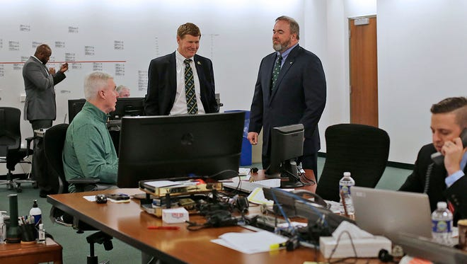 From left, Green Bay Packers general manager Ted Thompson, president Mark Murphy and coach Mike McCarthy visit with each other inside the war room during the NFL draft at Lambeau Field.