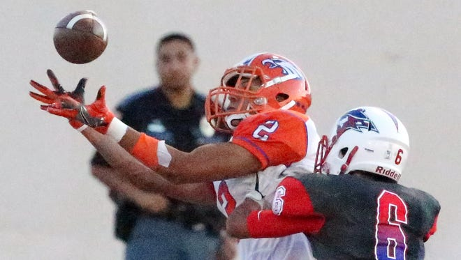 Canutillo wide receiver Joseph Paz, 2, reaches for a catch in the endzone for the first score of the game against Bel Air Friday night. Defending is Bel Air's Jacob Perez, 6.