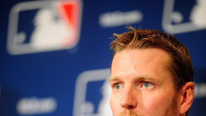 Roy Halladay announces his retirement the MLB Winter Meetings at Walt Disney World Swan and Dolphin Resort on Dec. 9. Halladay signed a one-day contract and retired with the Toronto Blue Jays. Mandatory Credit: David Manning-USA TODAY Sports