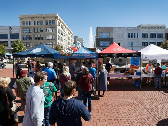 People line up at the beer tent during the Taste of SOMO & Oktoberfest Village event at Park Central Square on Saturday, October 8, 2016. The organizer of the event had trouble getting the proper permits for the event from the city.