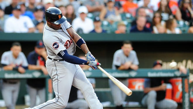 Tigers leftfielder Justin Upton (8) hits a home run in the first inning on Saturday, Aug 5, 2017, in Baltimore.