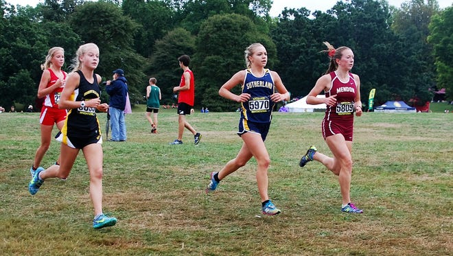 Runners from Pittsford Sutherland and Pittsford Mendon during a recent race.