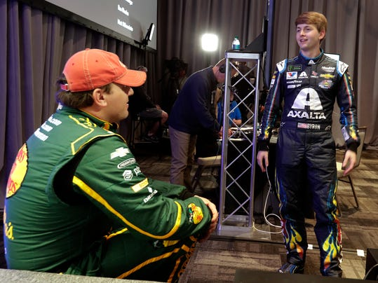 Ryan Newman, left, and William Byron talks during a break at media day for the NASCAR Daytona 500 auto race at Daytona International Speedway, Wednesday, Feb. 14, 2018, in Daytona Beach, Fla. (AP Photo/John Raoux)