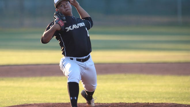 Xavier College Prep pitcher Alan Ferrer throws against La Quinta on Tuesday at La Quinta High School.