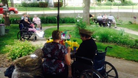 Juliette Manor residents, their families and staff enjoying the Juliette Manor garden during the fiesta.