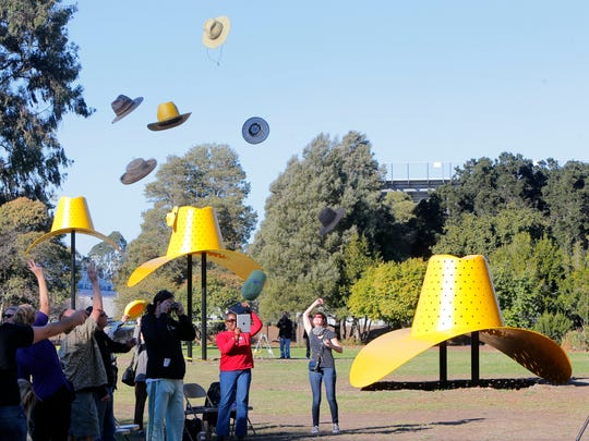"""Hats are flung into the air during the rededication of Claes Oldenburg's """"Hat in Three Stages of Landing"""" in Sherwood Park last November. The """"Hats"""" will share the stage, so to speak, with country music artists during four free concerts this summer."""
