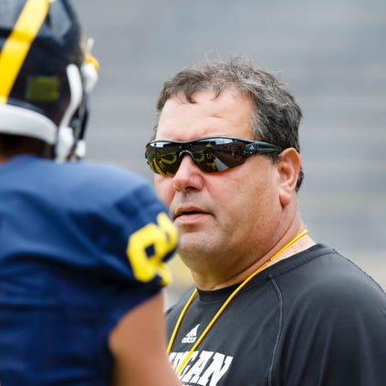 Michigan football coach Brady Hoke looks on before a game against Utah at Michigan Stadium.