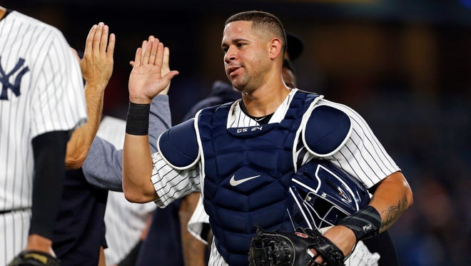Aug 14, 2017; Bronx, NY, USA; New York Yankees catcher Gary Sanchez (24) celebrates defeating the New York Mets at Yankee Stadium.