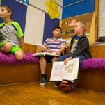 Luca Gaiser, Jason Ventura-Turcios and Travis Ivers take part in a summer reading program at Park Avenue Elementary School in Des Moines Thursday, July 7th, 2016. Des Moines schools are piloting summer reading programs to help struggling third grade readers. If kids do not attend summer school, they will be retained if they are behind in reading.